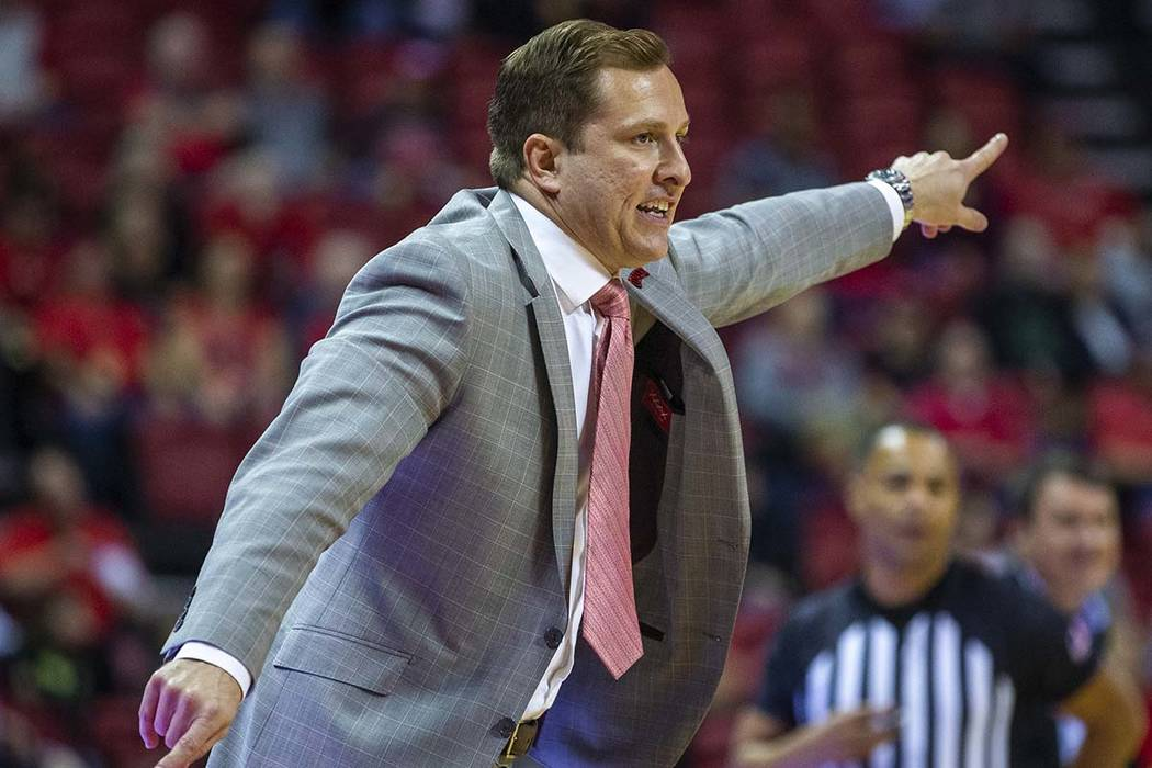UNLV Rebels head coach T.J.Otzelberger directs his defense versus the Abilene Christian Wildcat ...