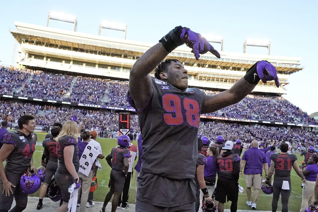 TCU defensive end Adam Plant Jr. (98) celebrates in the bench area during the final seconds of ...