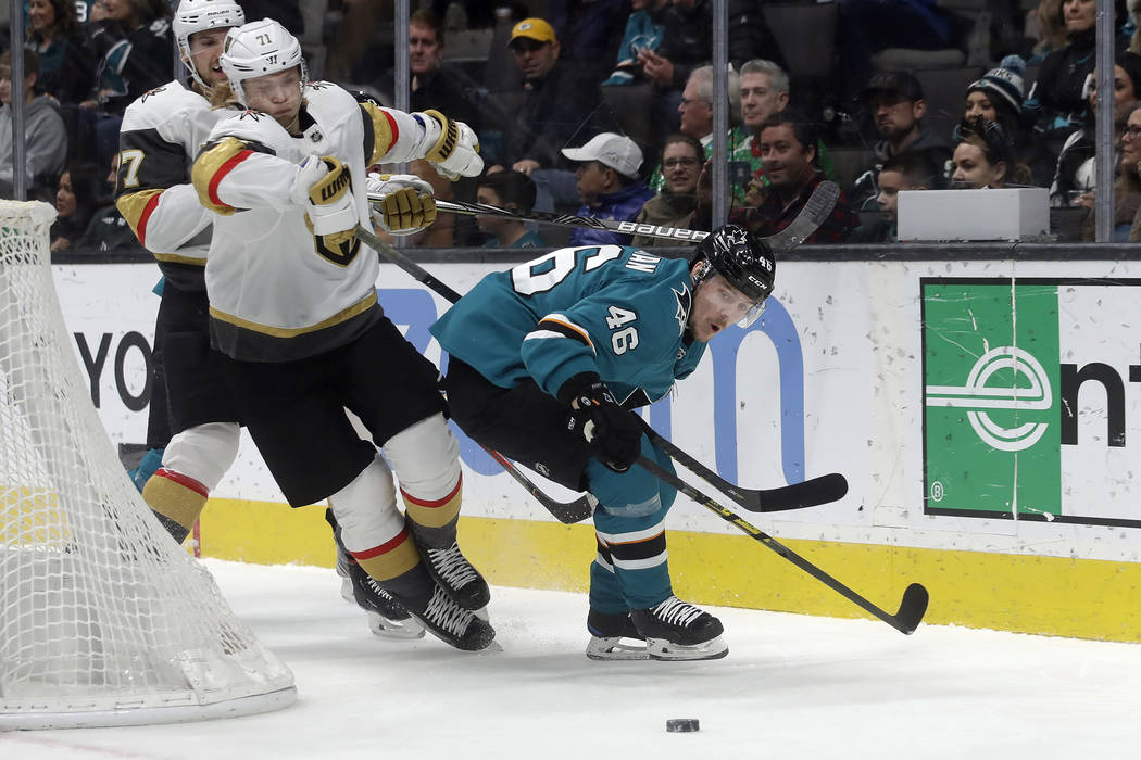 Vegas Golden Knights center William Karlsson, foreground left, goes after the puck next to San ...