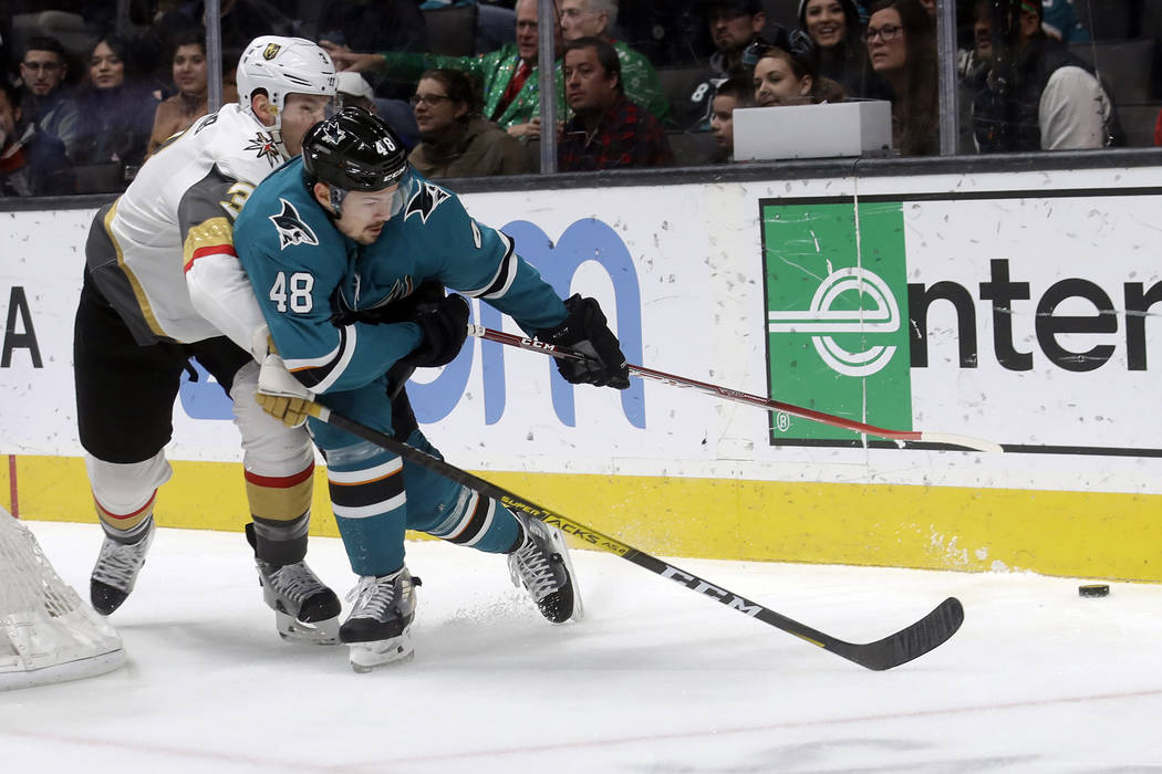 San Jose Sharks center Tomas Hertl (48) reaches for the puck in front of Vegas Golden Knights d ...