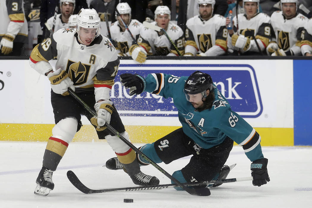 Vegas Golden Knights right wing Reilly Smith (19) reaches for the puck over San Jose Sharks def ...