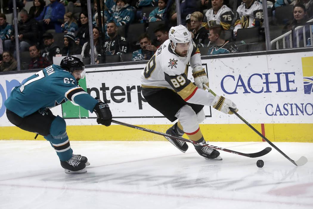 Vegas Golden Knights right wing Alex Tuch (89) skates in front of San Jose Sharks defenseman Ja ...