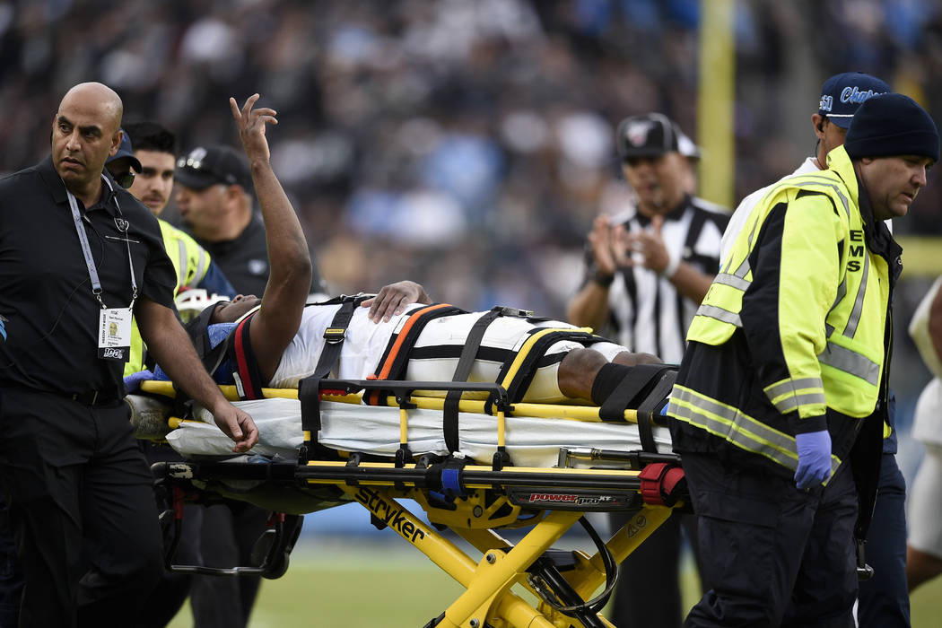 Oakland Raiders cornerback Trayvon Mullen is taken off the field after being hurt during the se ...