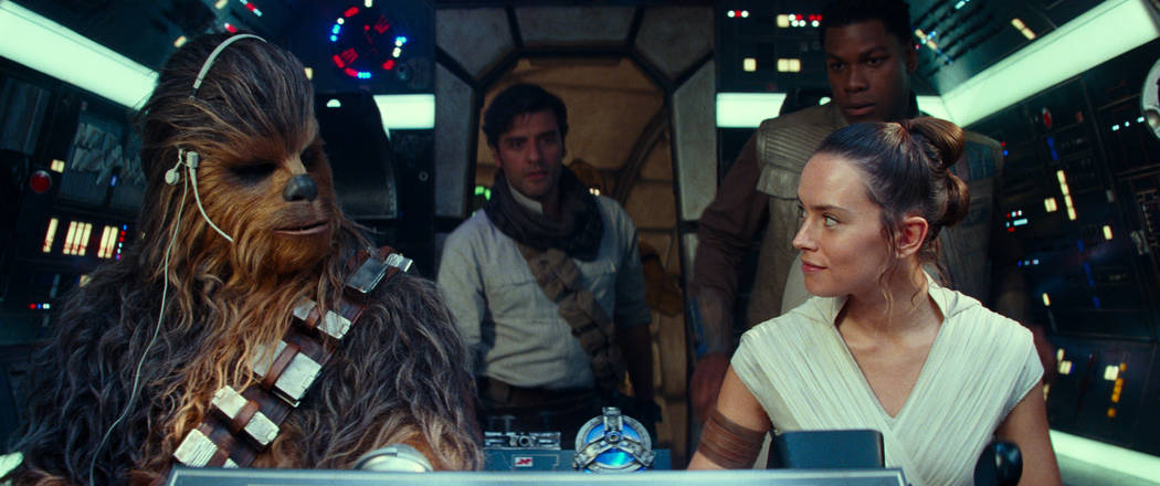 This image released by Disney/Lucasfilm shows, from left, Joonas Suotamo as Chewbacca, Oscar I ...
