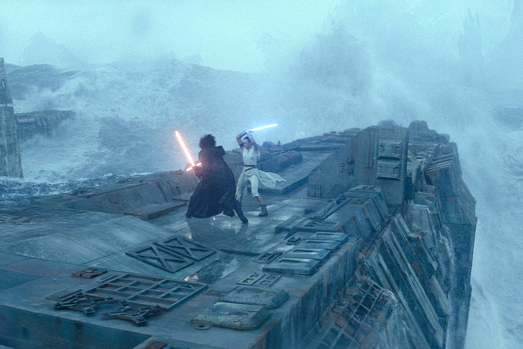 This image released by Lucasfilm shows Adam Driver as Kylo Ren, left, and Daisy Ridley as Rey i ...