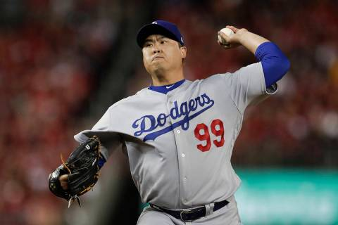 In this Oct. 6, 2019, file photo, Los Angeles Dodgers starting pitcher Hyun-Jin Ryu throws to a ...