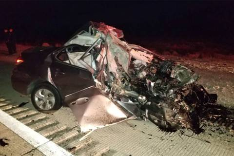 A vehicle is seen at the site of a fatal crash in the northbound lanes of I-15 near Jean, south ...