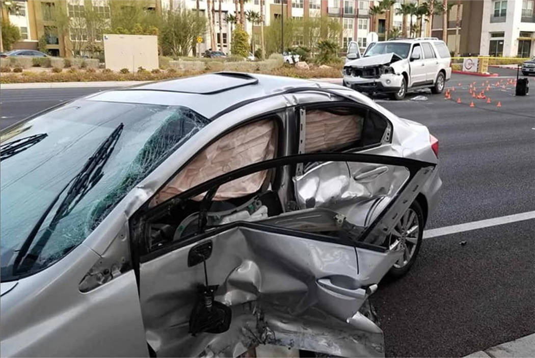 Officers respond to a fatal crash at Buffalo and Peak drives in Las Vegas on Saturday, Dec. 21, ...