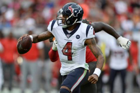 Houston Texans quarterback Deshaun Watson (4) runs against the Tampa Bay Buccaneers during the ...