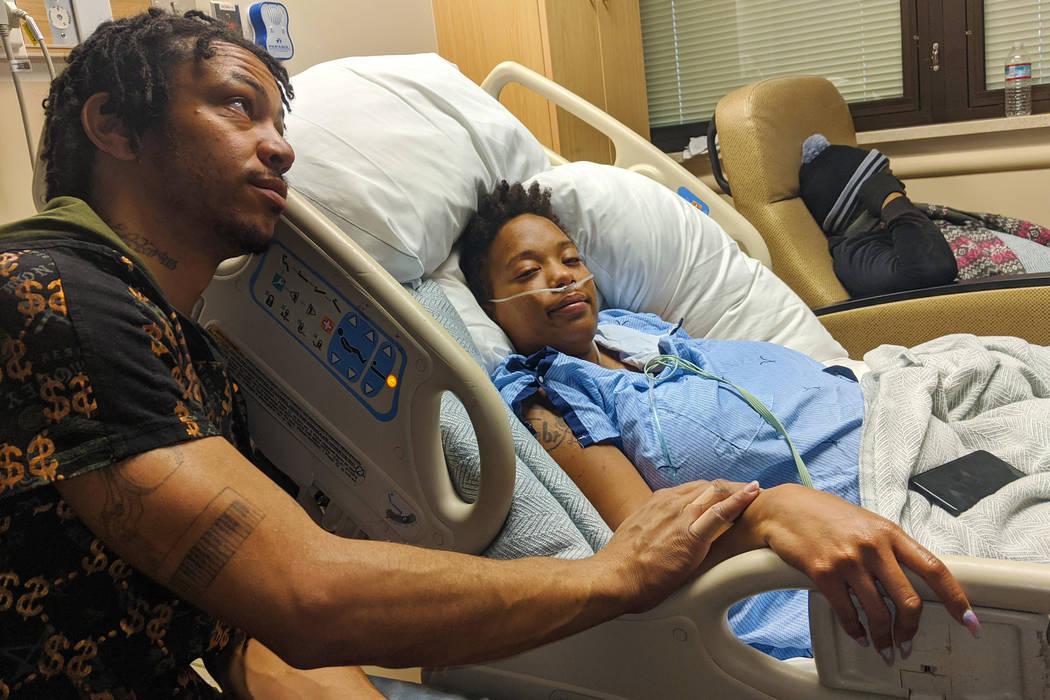 Johnathan Wilson comforts his wife, DeJoy Wilson, on Monday, Dec. 23, 2019, at Sunrise Hospital ...