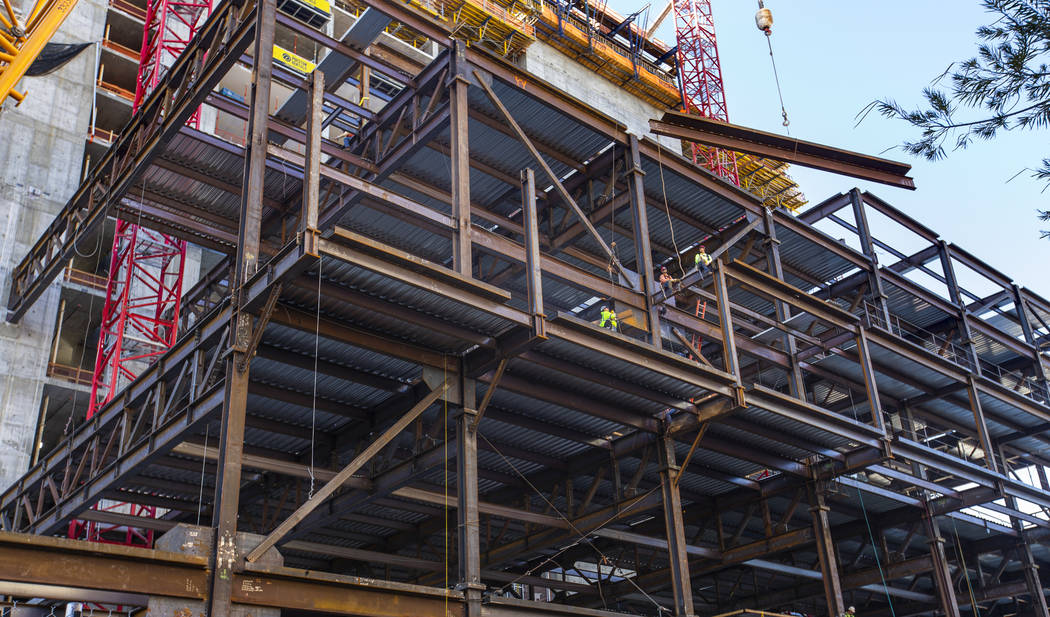 Workers ready to secure another beam being brought up during a construction tour of the Circa o ...