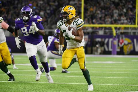 Green Bay Packers running back Aaron Jones (33) scores on a 56-yard touchdown run during the se ...