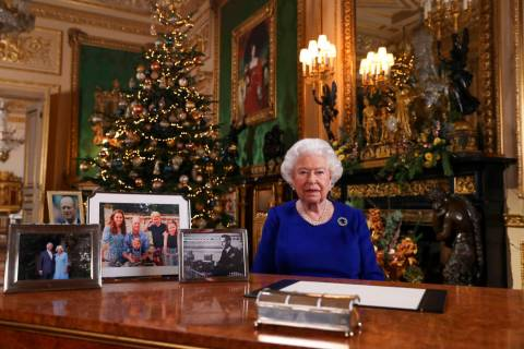 In this image released Tuesday Dec. 24, 2019, Britain's Queen Elizabeth II poses for a photo, w ...