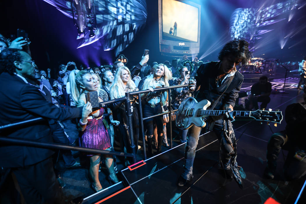 Joe Perry of Aerosmith is shown performing on the bar in the onstage VIP section at Park Theate ...
