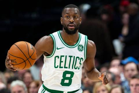 Boston Celtics guard Kemba Walker (8) dribbles the ball during the first half of an NBA basketb ...