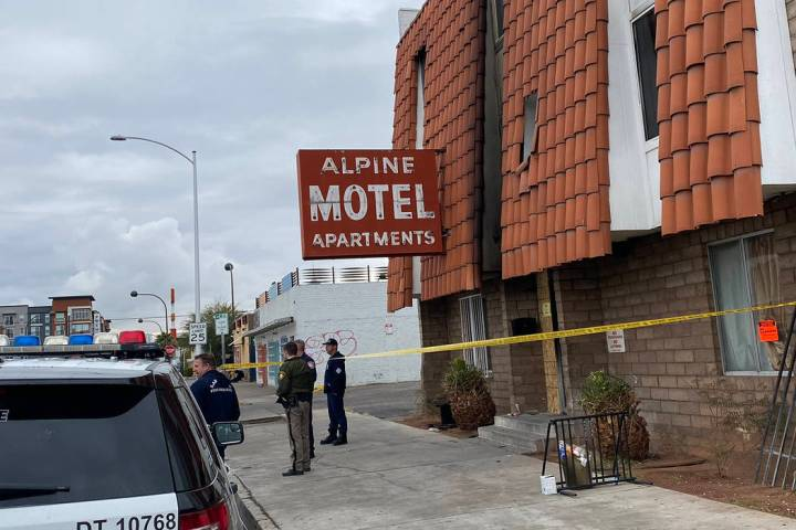 Metropolitan Police officers stand in front of the Alpine Motel apartments in Las Vegas on Tues ...