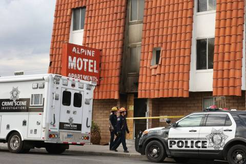 Las Vegas Police Department crime scene investigations truck is parked outside the Alpine Motel ...