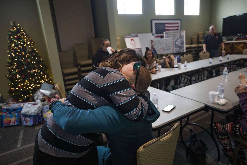 Michelle Aikens hugs her husband Michael Aikens, both survivors of the Alpine Motel fire, at SH ...