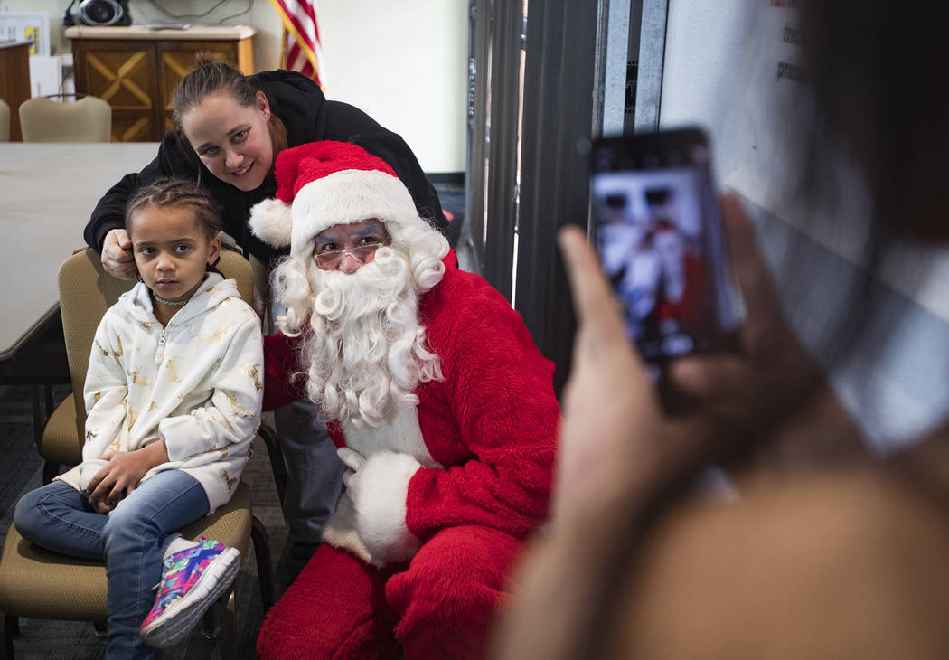 Maya Rodriguez, 7, left, and her mom Michelle Rodriguez, center, both survivors of the Alpine M ...