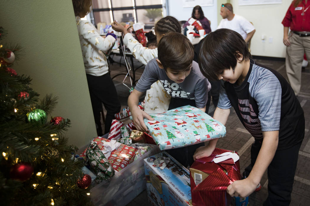 Michael Aikens, 8, left, and Miguel Rodriguez, 8, right, both survivors of the Alpine Motel fir ...
