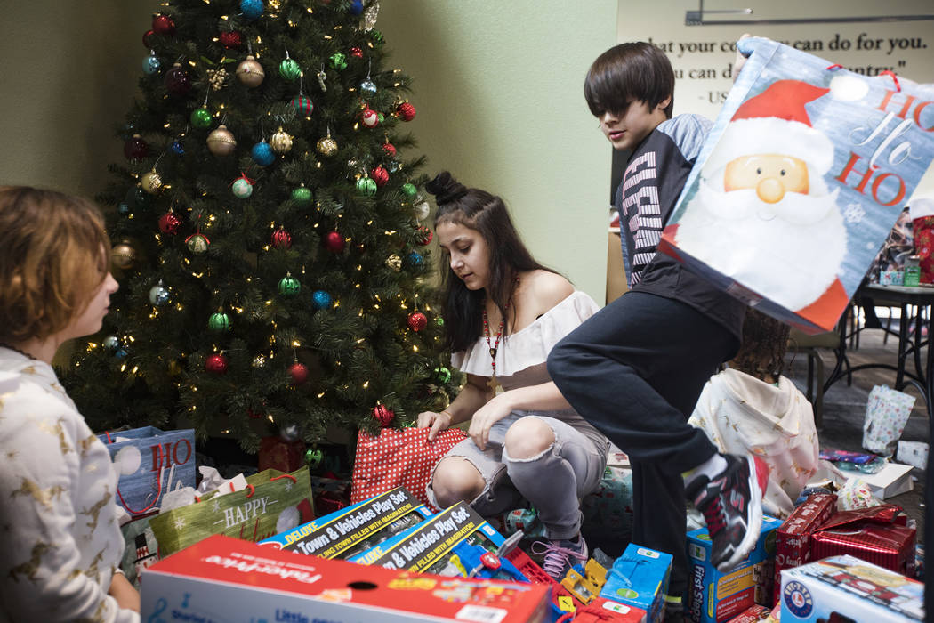 Brianna Aikens, 11, from left, Michelle Rodriguez, 13, her brother Miguel Rodriguez, 8, right, ...