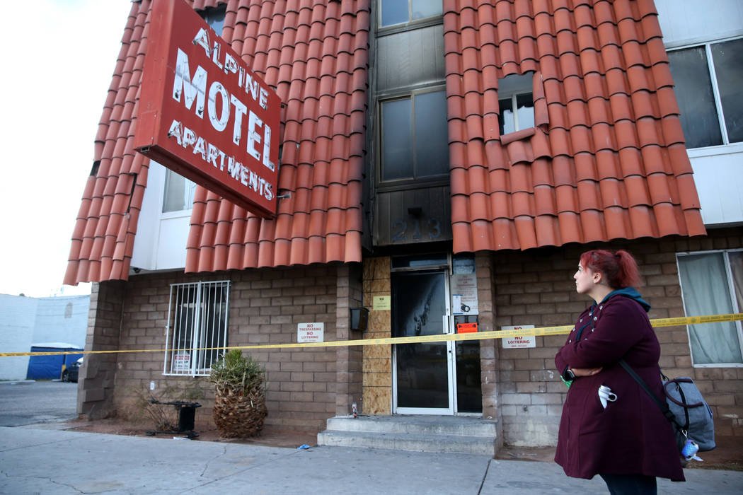 Scotti Hughes, 31, revisits on Tuesday, Dec. 24, 2019, the site of the deadly Alpine Motel Apar ...