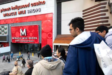 Holiday shoppers walk through Miracle Mile Shops on Tuesday, Dec. 24, 2019, in Las Vegas. The m ...
