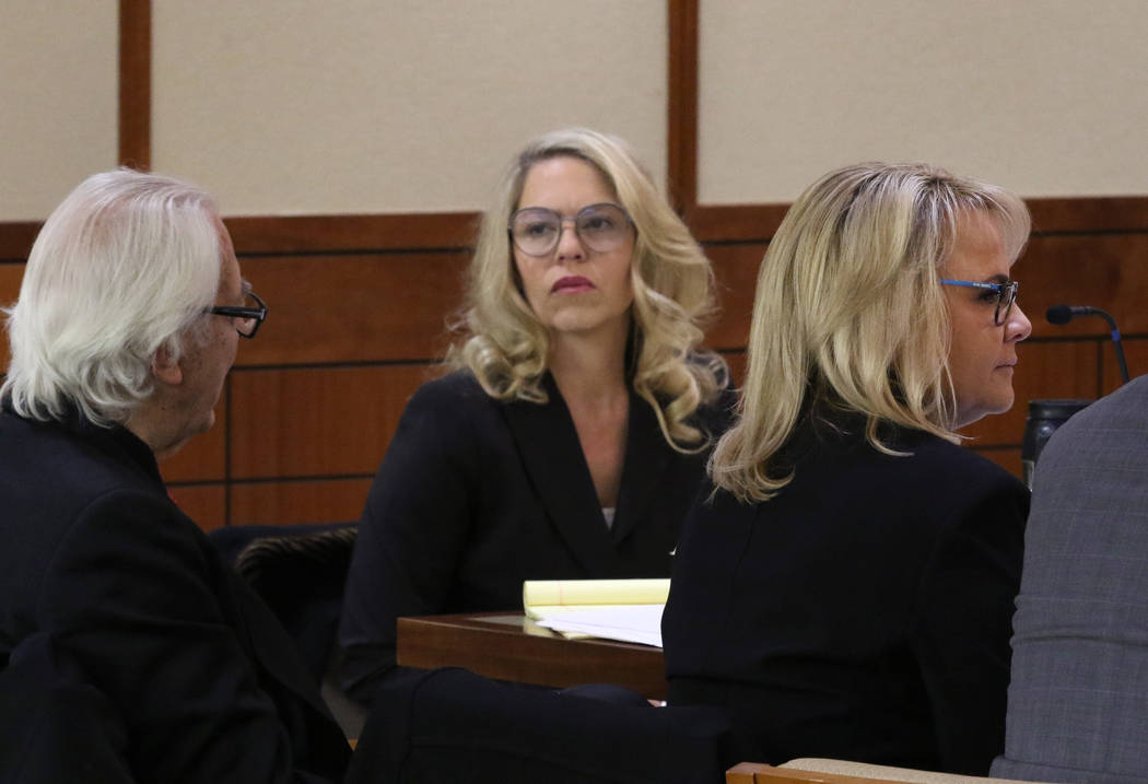 Las Vegas Justices of the Peace Melanie Andress-Tobiasson, center, and Amy Chelini, listen as a ...