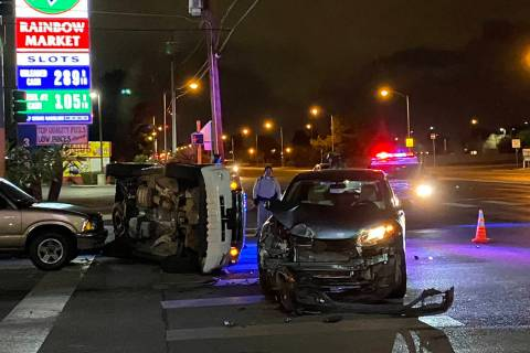 Police investigate a crash Tuesday, Dec. 24, 2019, at East Lake Mead Boulevard and North Walnut ...