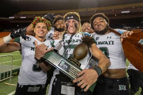 Hawaii wide receiver Jason-Matthew Sharsh, left, quarterback Cole McDonald, center, and defensi ...