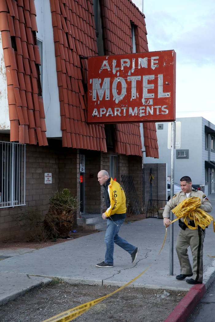 Las Vegas police remove crime scene tape at the Alpine Motel Apartments Wednesday, Dec. 25, 201 ...