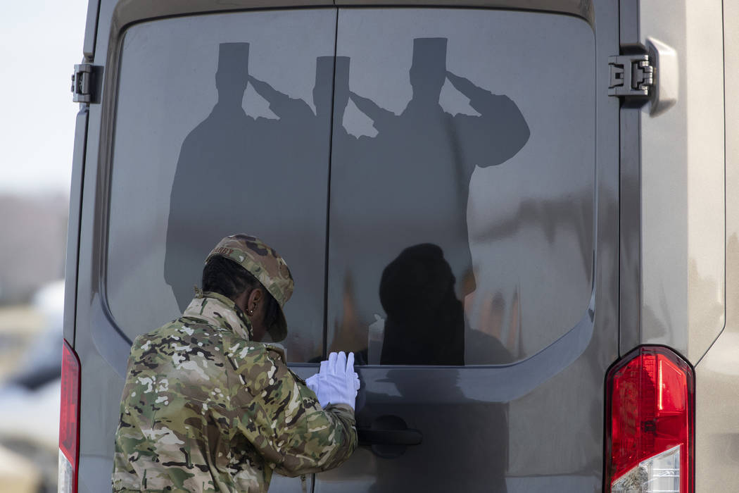 U.S. Air Force Tech. Sgt. Shaquita Darby closes the door of a vehicle containing a transfer cas ...