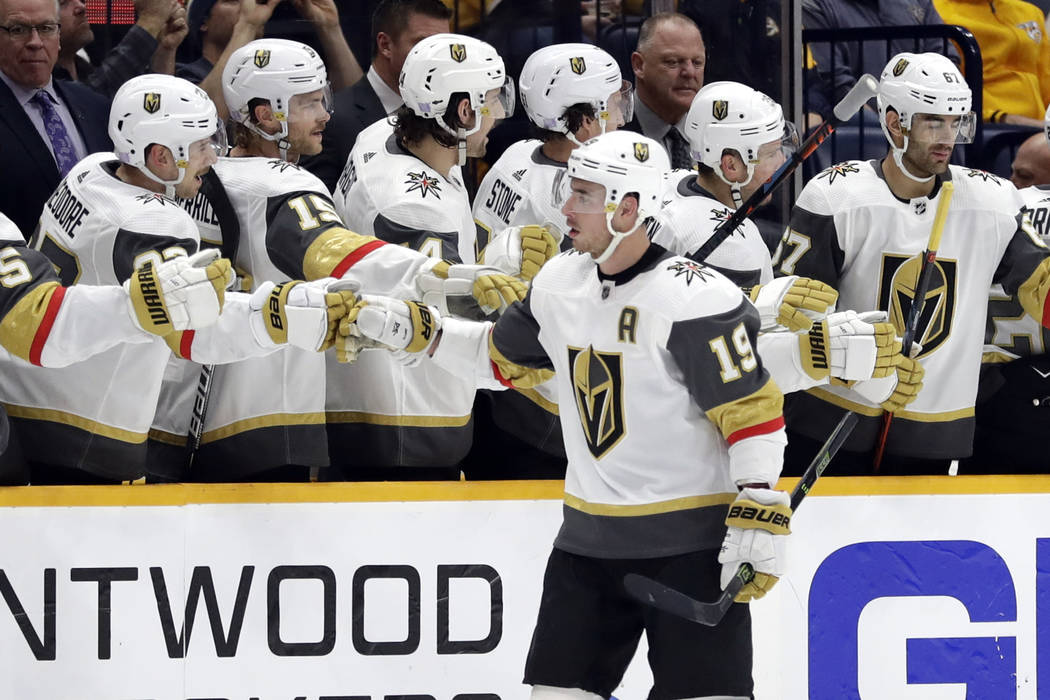 Vegas Golden Knights right wing Reilly Smith (19) is congratulated after scoring a goal against ...