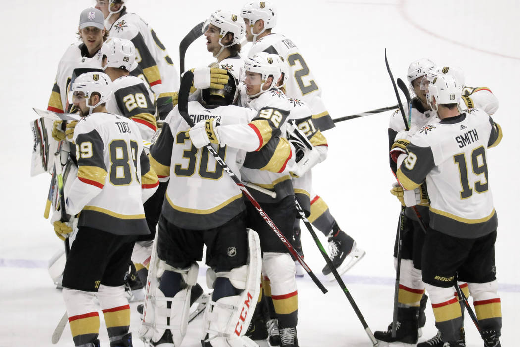 Vegas Golden Knights players celebrate after beating the Nashville Predators 4-3 in overtime of ...