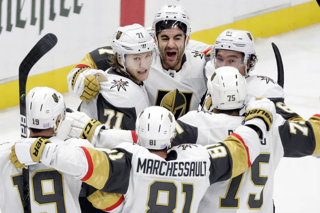 Vegas Golden Knights left wing Max Pacioretty (67), top center, celebrates with teammates after ...