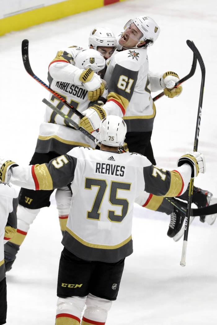Vegas Golden Knights left wing Max Pacioretty (67), top center, celebrates with Mark Stone (61) ...