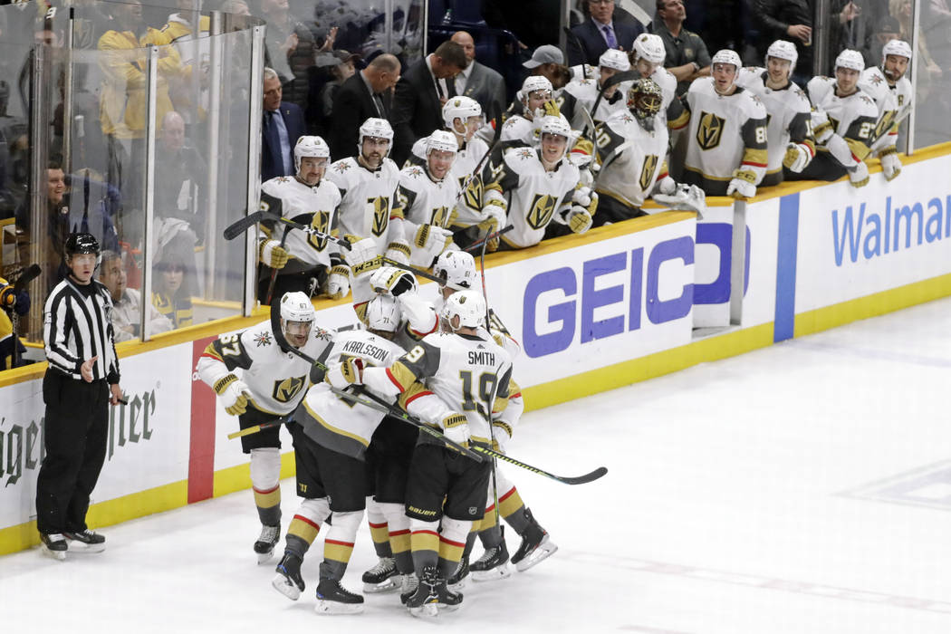 Vegas Golden Knights players celebrate after Max Pacioretty scored the tying goal against the N ...