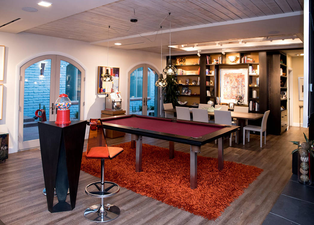Part of the living room also serves as a game room. (Tonya Harvey Real Estate Millions)