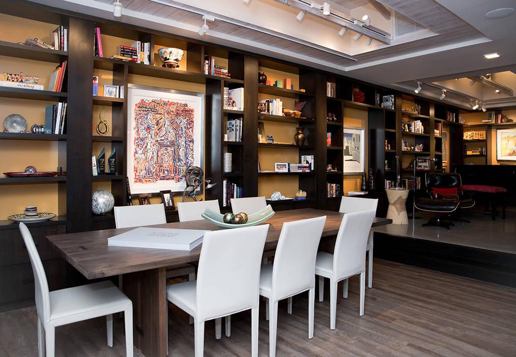 A wall of book shelves line the living room. (Tonya Harvey Real Estate Millions)