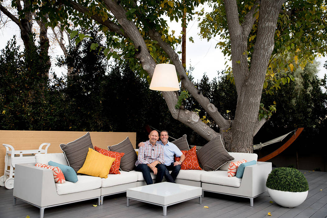 Architects John Klai and Jon Sparer sit in the backyard of their 1950s midcentury home they rem ...