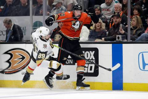 Anaheim Ducks' Nicolas Deslauriers, right, collides with Vegas Golden Knights' Alex Tuch (89) d ...