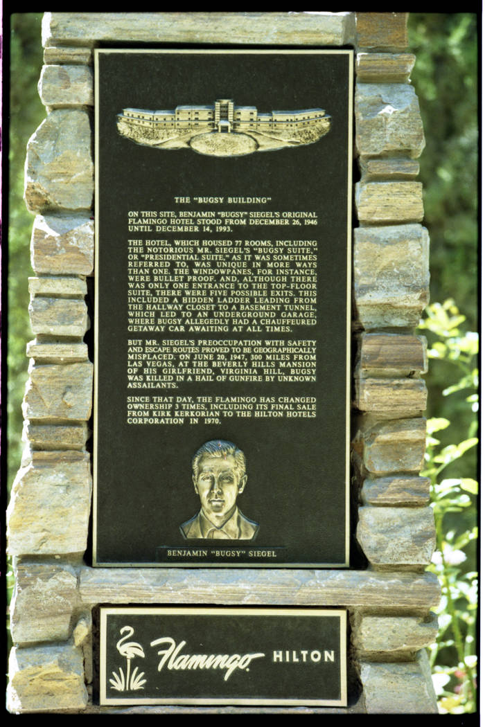 This 1997 photo shows the images of a commemorative plaque located at the Flamingo Hilton. The ...