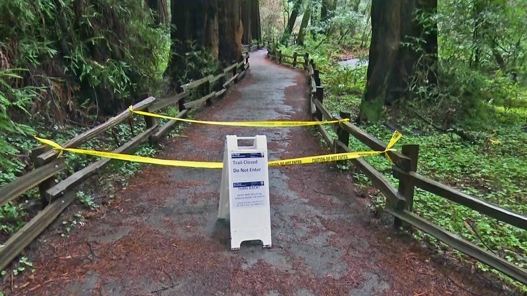 In this photo provided by CBS San Francisco shows a sign showing a trail closed sign at the ent ...