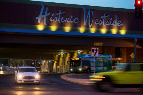 Traffic moves along Bonanza Road past the Historic Westside sign above F Street in Las Vegas on ...