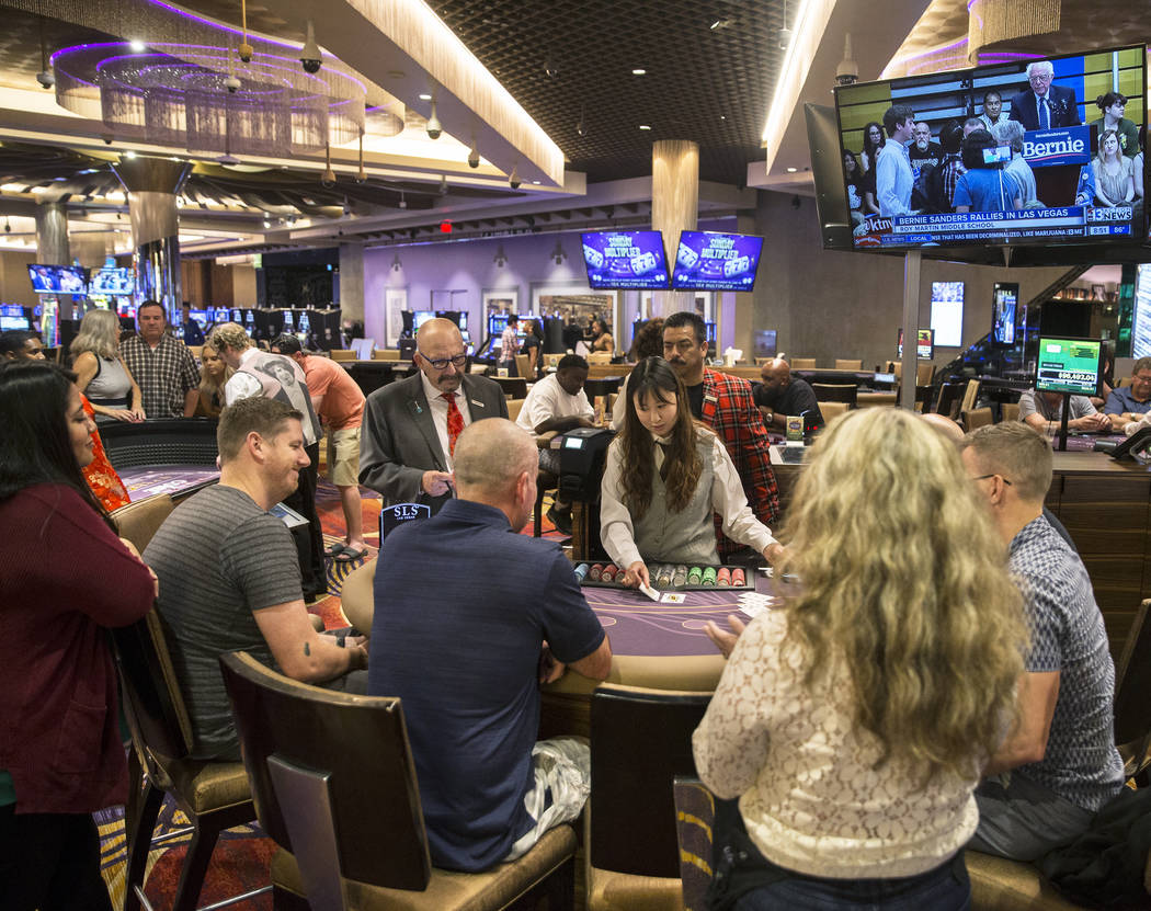 Gamblers play blackjack at SLS Las Vegas on Thursday, May, 30, 2019, in Las Vegas. (Benjamin Ha ...