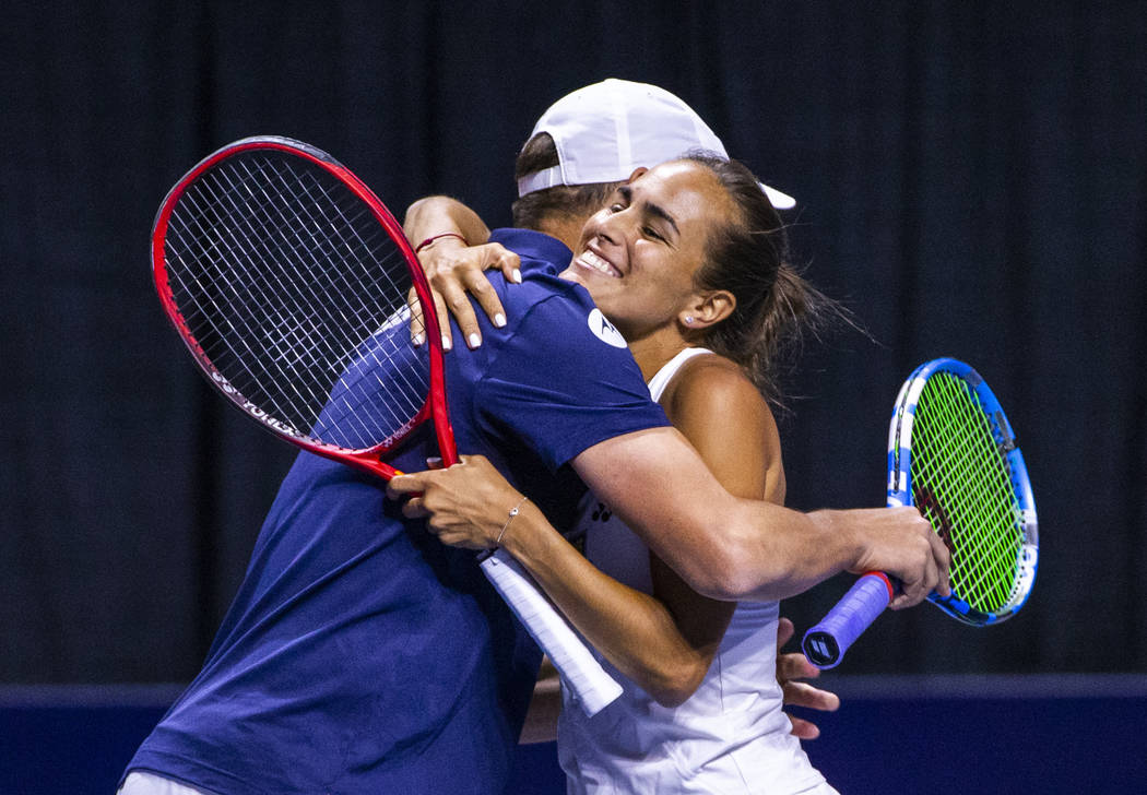 The Vegas Rollers' Bob Bryan, left, embraces mixed doubles parter Monica Puig, 2016 Rio Olympic ...