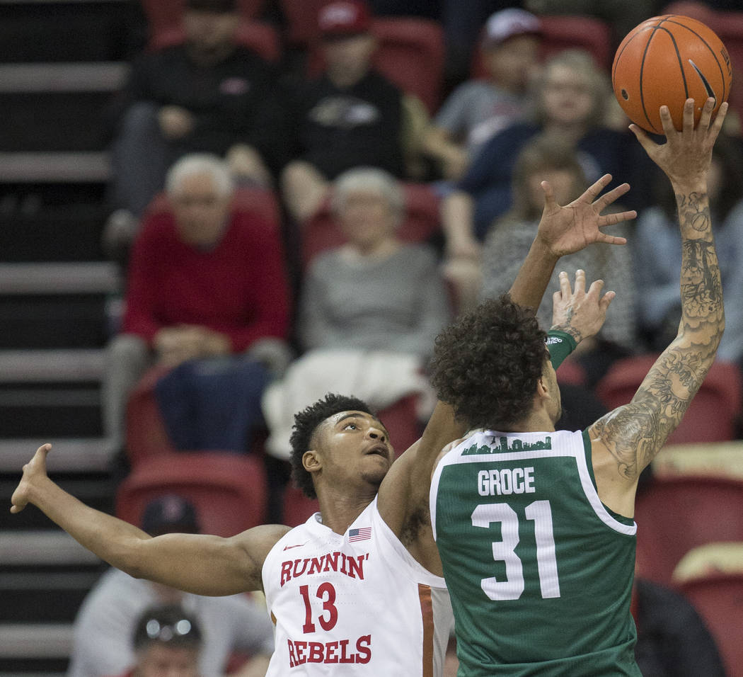 UNLV Rebels guard Bryce Hamilton (13) reaches out to block the shot of Eastern Michigan Eagles ...