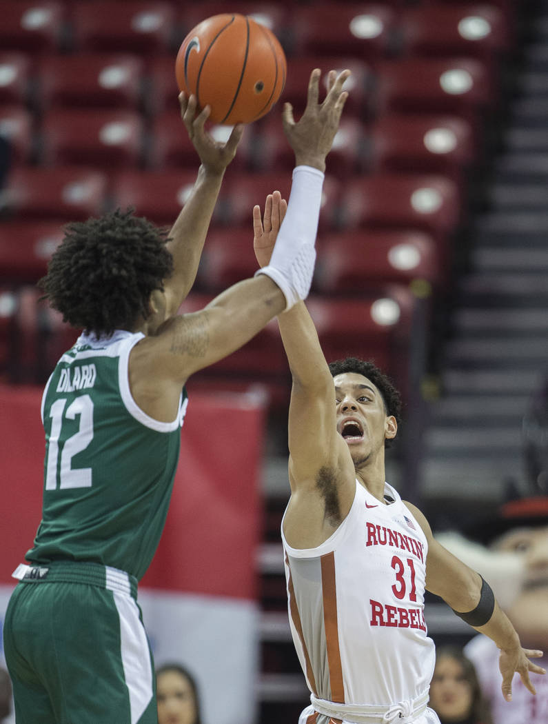 UNLV Rebels guard Marvin Coleman (31) extends to block the shot of Eastern Michigan Eagles guar ...