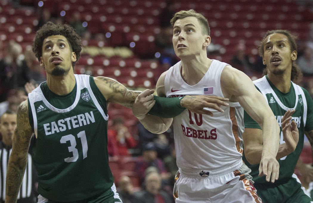 UNLV Rebels guard Jonah Antonio (10) fight for position with Eastern Michigan Eagles forward Ty ...
