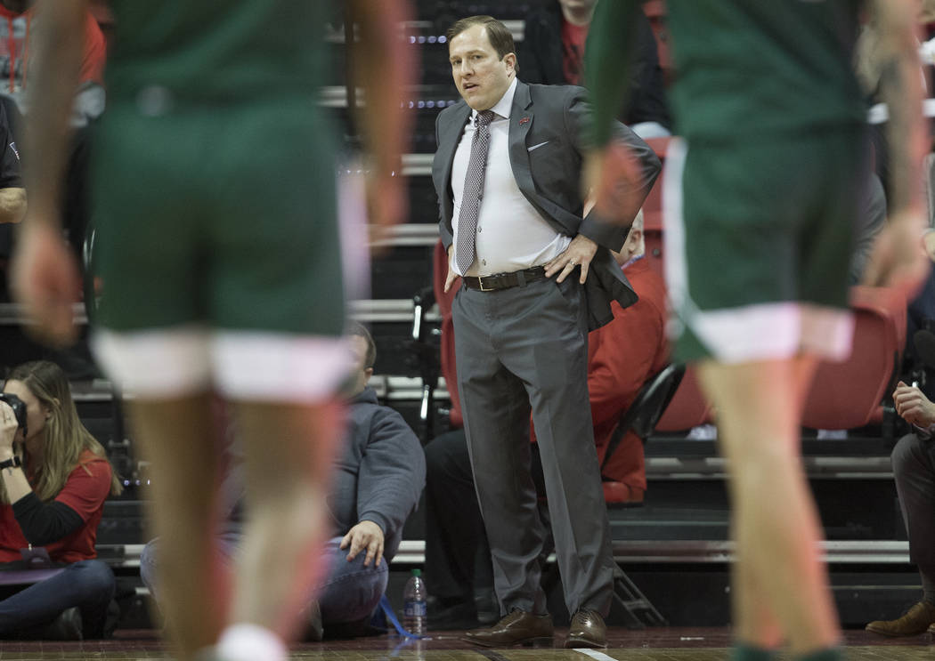 UNLV Rebels head coach T.J. Otzelberger watches over his team in the first half during an NCAA ...
